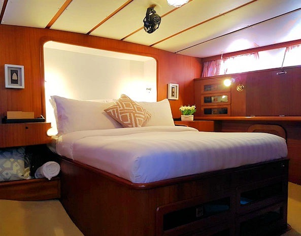 The Master Stateroom with side tables, desk and lots of storage